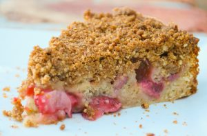 Strawberry Streusel Cake on white plate with bricks in background