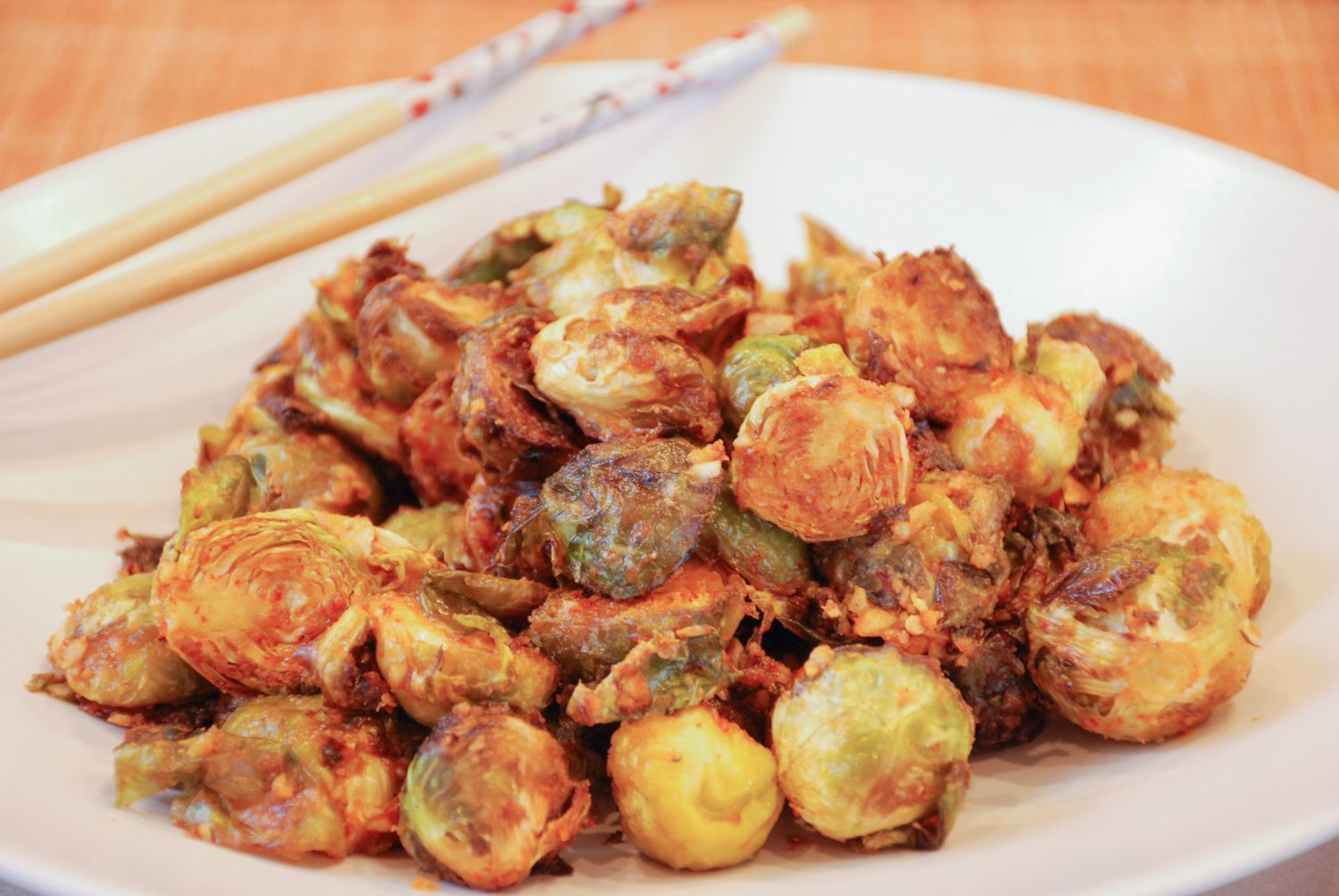 Roasted Brussels Sprouts in a Sriracha Peanut Sauce