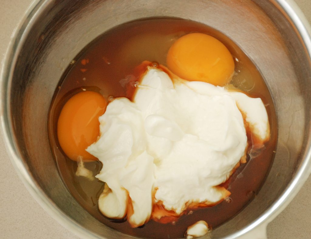 Adding Eggs and Sour Cream