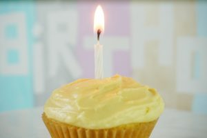 Mango cupcakes with birthday candle