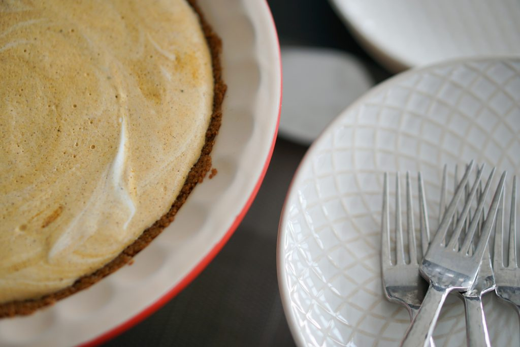 Frozen pumpkin pie with fork and plate