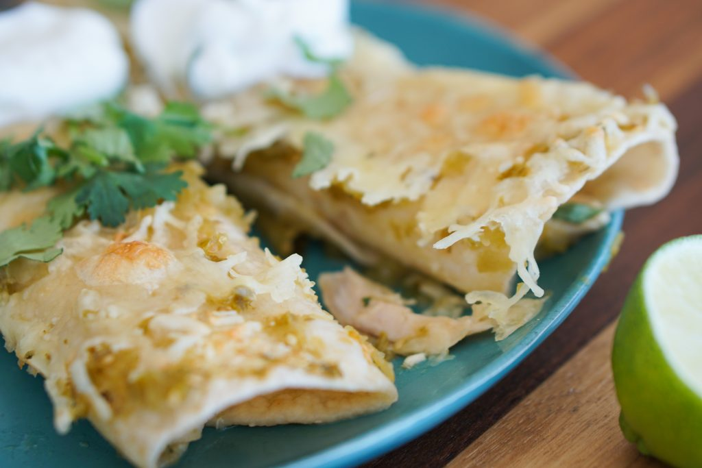 Enchiladas on plate with sour cream