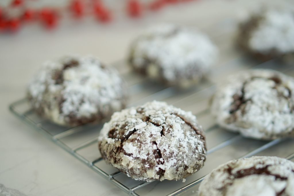 Chocolate Peppermint cookie on cooling rack with red balls in background