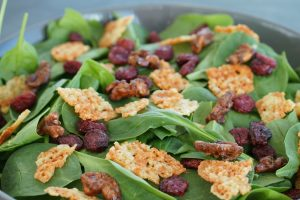 Autumn Spinach Salad with Cheese Crisps Candied Walnuts and Cranberries