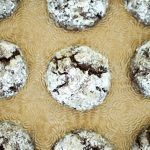 Birds eye view of chocolate peppermint crackles on gold textured background