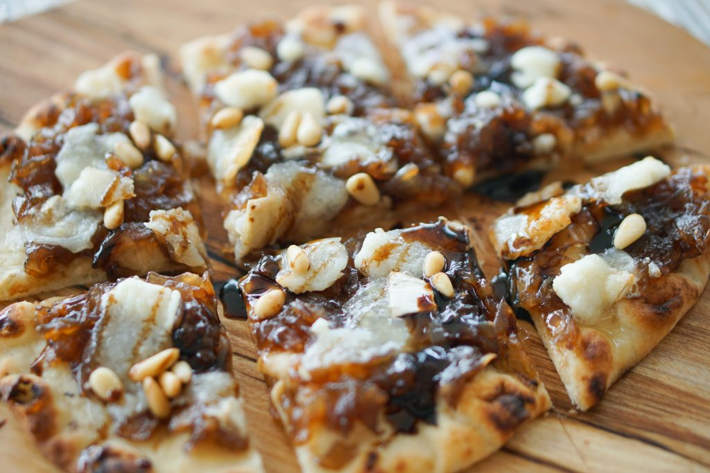 Onion jam and goat cheese flatbread sliced into 6 squares