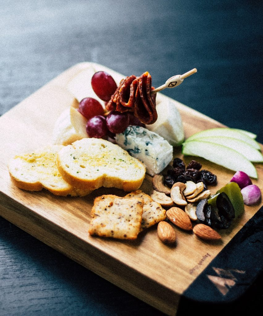Cheese board for two with nuts crackers fruit and meat
