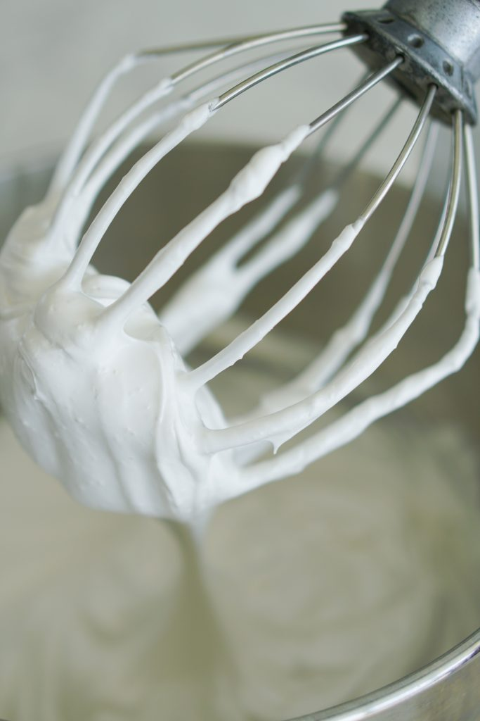 Whisk attachment with whipped egg whites and sugar