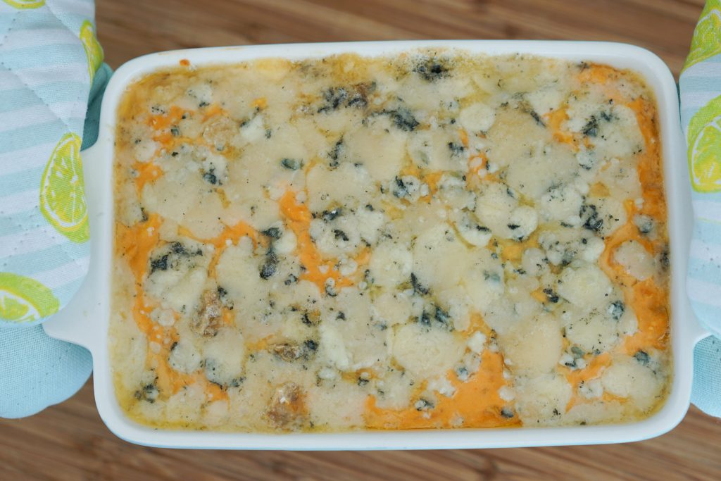 Top down of Buffalo style bean dip smothered in blue cheese
