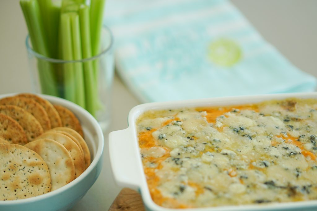 Buffalo bean dip with crackers and celery in background