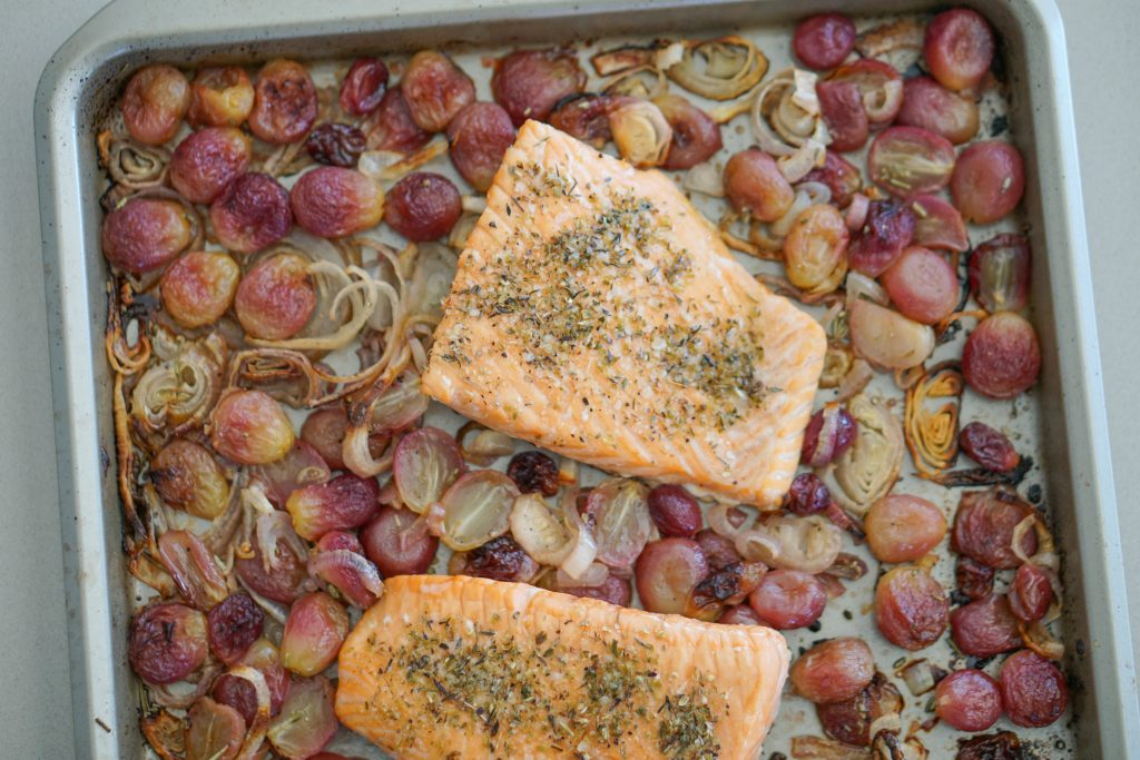Roasted salmon on sheet pan with roasted grapes and shallots