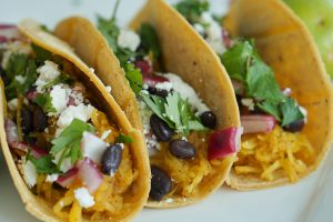 Squash tacos with beans and pickled onions