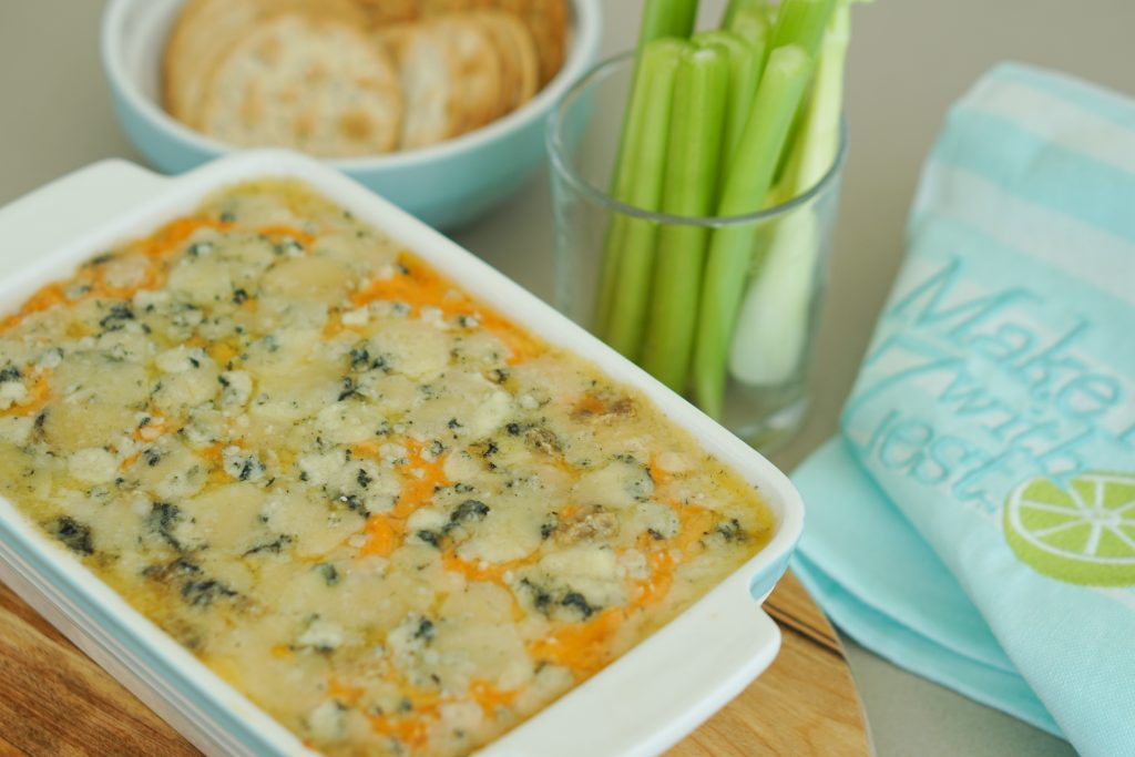 Buffalo style bean dip with celery and crackers in background