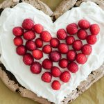Heart-shaped Chocolate Pavlova topped with Gingered Cream & Berries