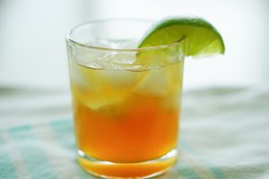 The Southerly cocktail with lime wedge in rocks glass