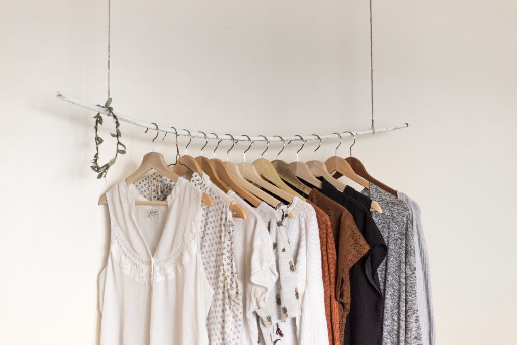 Shirts on hangers suspended on a hanging rod