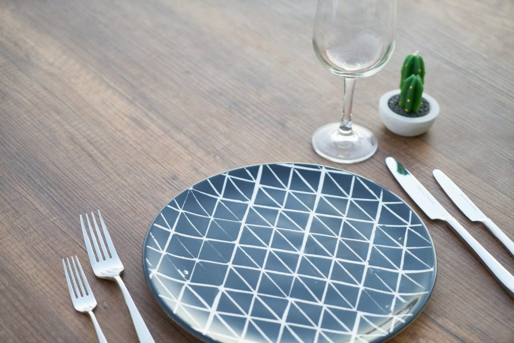 Table Setting with blue plate silverware wine glass
