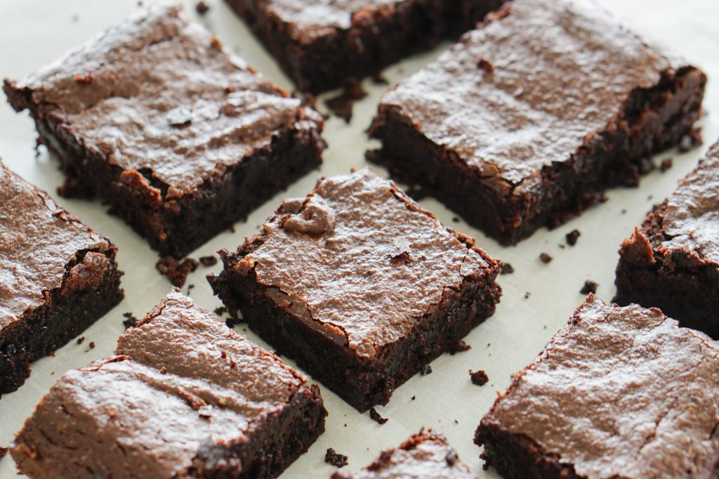 Gluten Free fudgy brownies on parchment