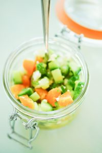 Cucumber, Poblano & Orange Salsa in a glass jar with orange gasket and metal clasp