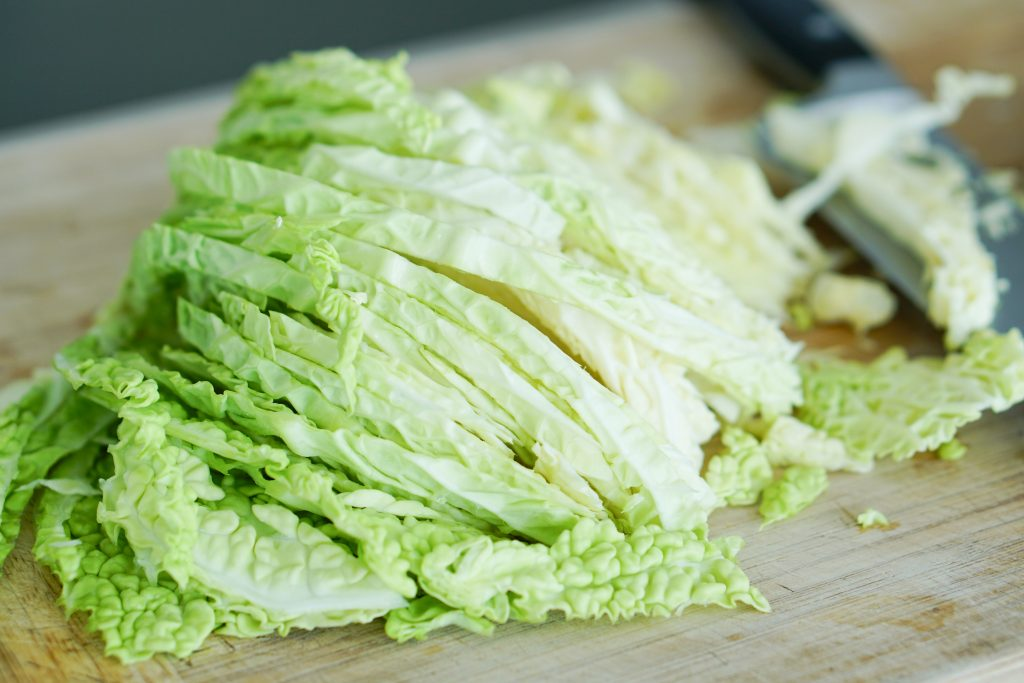 Sliced cabbage on cutting board
