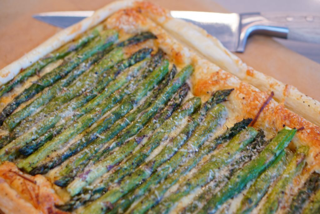 Asparagus and Gruyere Tart with chefs knife in background