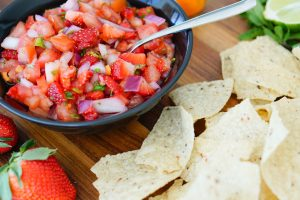 Tomato Strawberry Salsa with chips in foreground