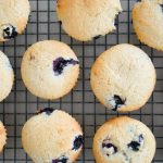 Top down of blueberry muffins on cooling rack