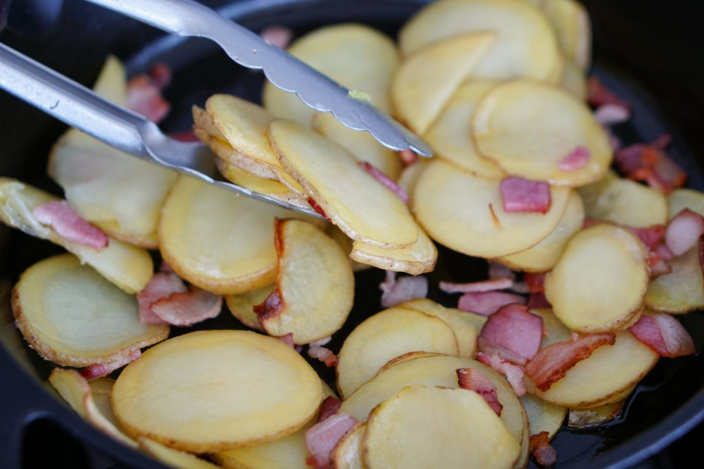 Sauted sliced potatoes with bacon
