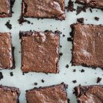 Top down photo of gluten free brownies on parchment paper