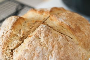 Close up of irish soda bread with cooling rack in background