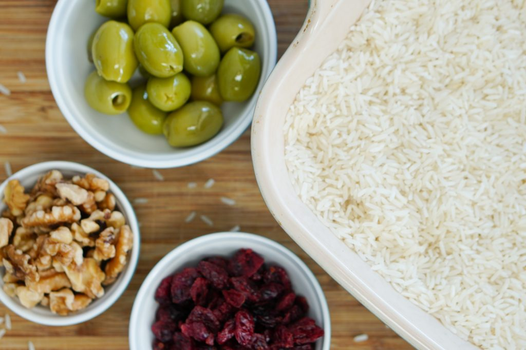 rice in baking dish with olives nuts and dried fruit