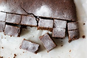 top lay of gingerbread cake cut into bite sized pieces topped with powdered sugar