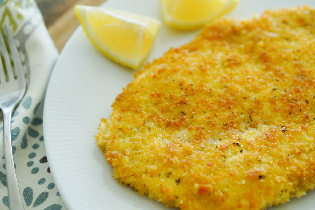 Chicken Schnitzel plated with lemon slices