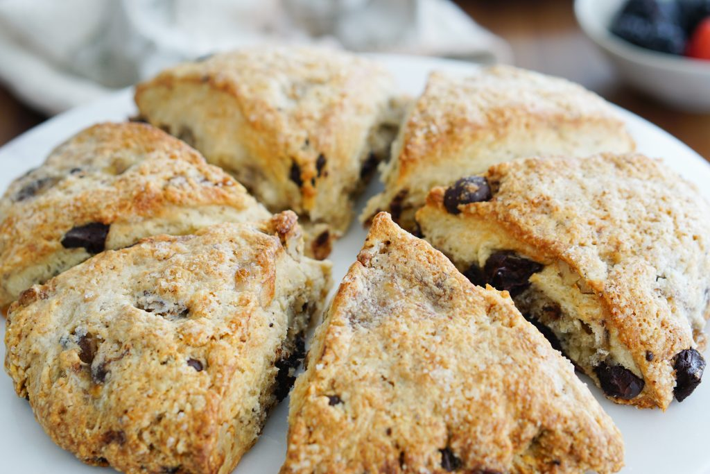 Chunky monkey scones with berries in background
