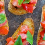Top lay of bruschetta with tomatoes and basil