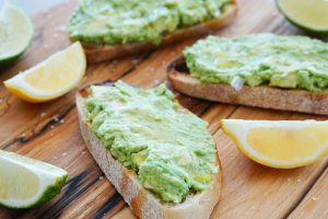 Avocado Toast with olive oil and salt on cutting board