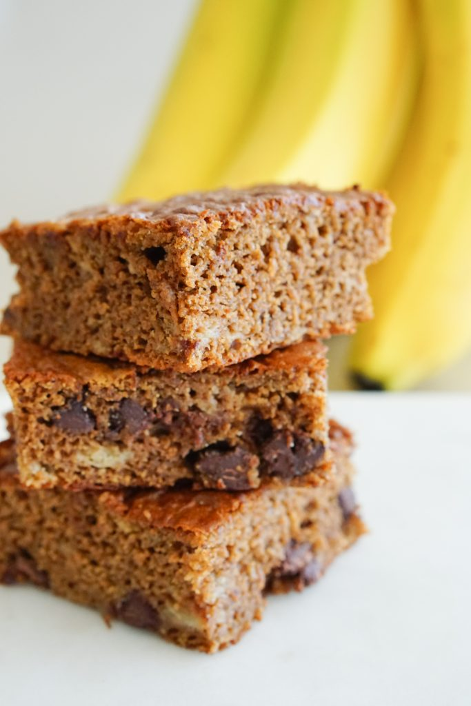 Banana Alond Butter bars with banana in background