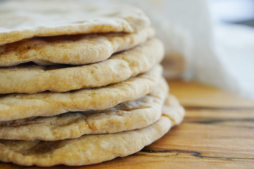 Flatbreads stacked on cutting board