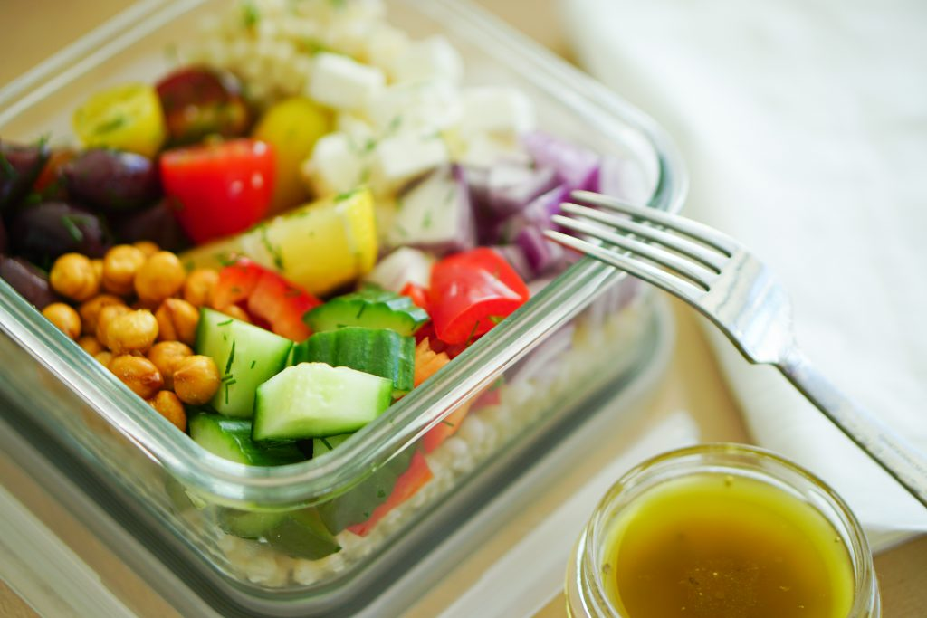 Greek-Style Couscous Salad in a to-go container