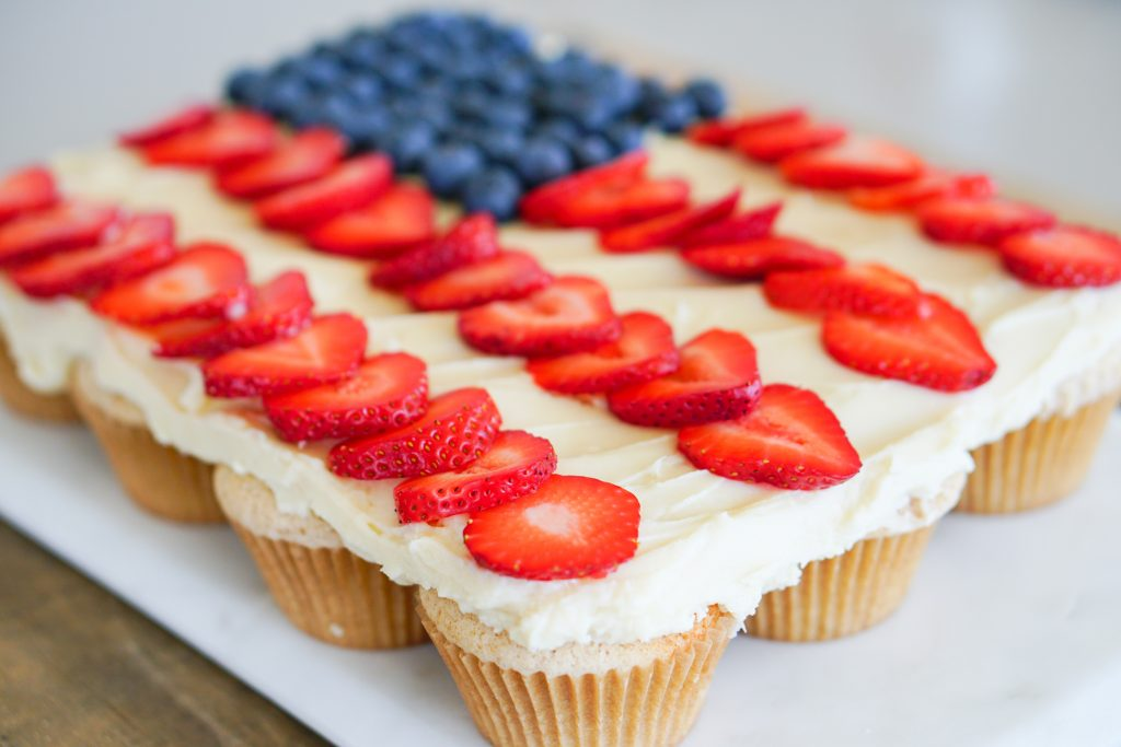 Diagonal view of Pull-Apart cupcakes topped with blueberries and strawberries in US flag design