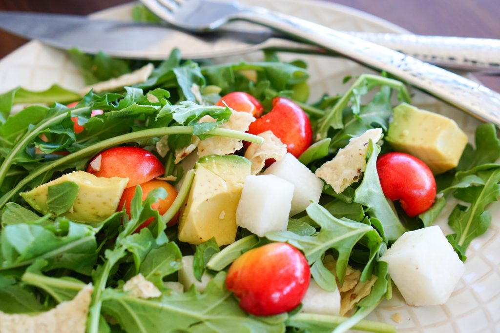 Arugula, Cherry & Jicama Salad on salad plate