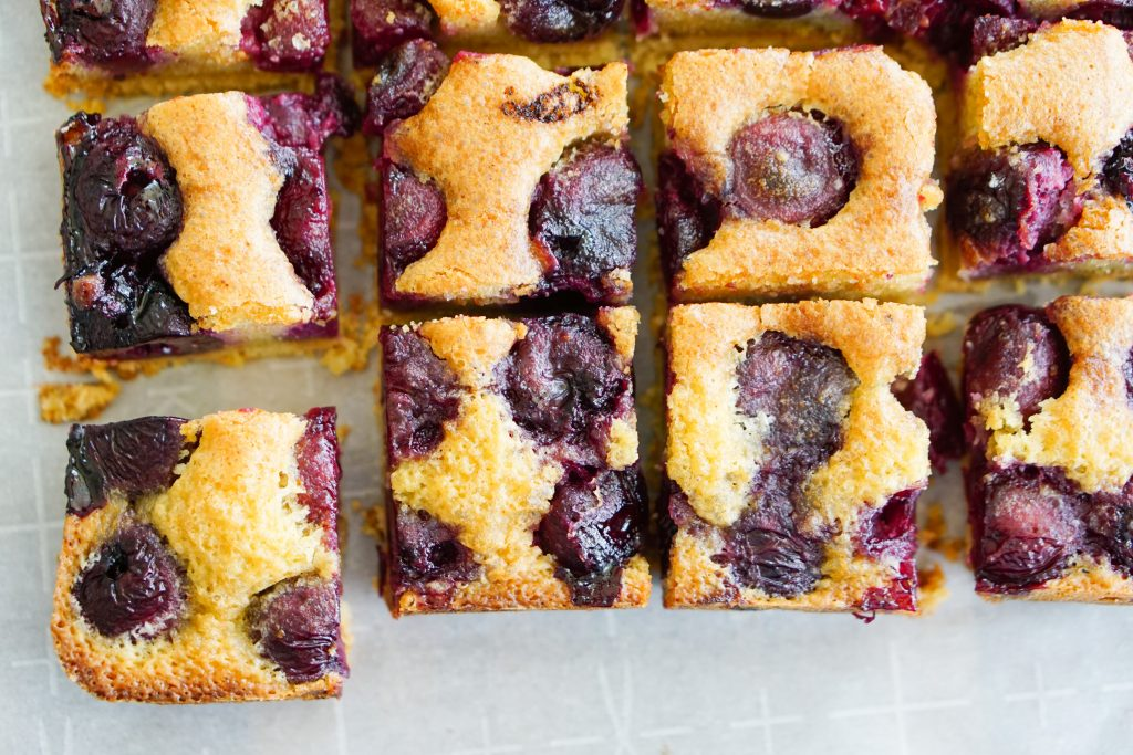 Cherry Almond Brown Butter Squares sliced in squares shown from top down view in grid