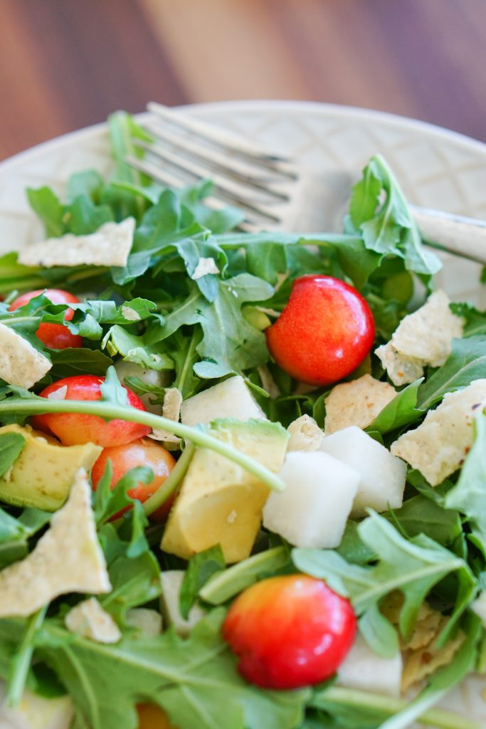 Arugula, Cherry & Jicama Salad with salad fork