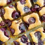 Cherry Almond Brown Butter Squares sliced in squares shown from angled view in diagnol