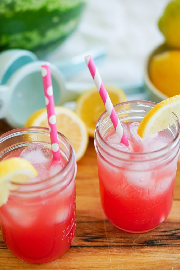 Watermelon lemonade in mason jars with Key Lime Lexi citrus squeezer and lemons in background