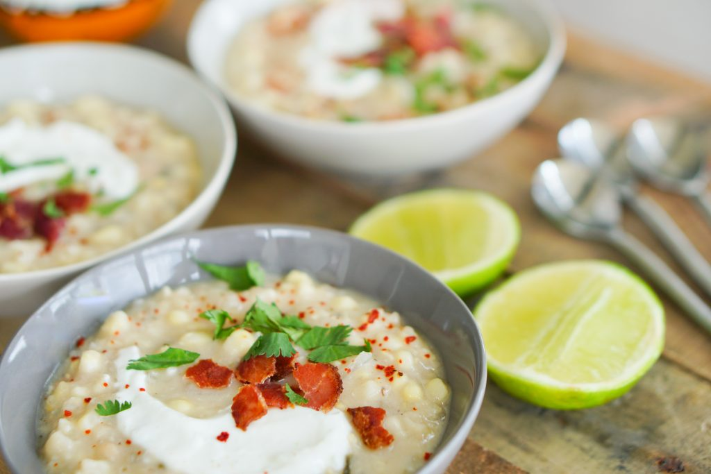 Side angle with chowder in bowls topped with bacon and lime crema