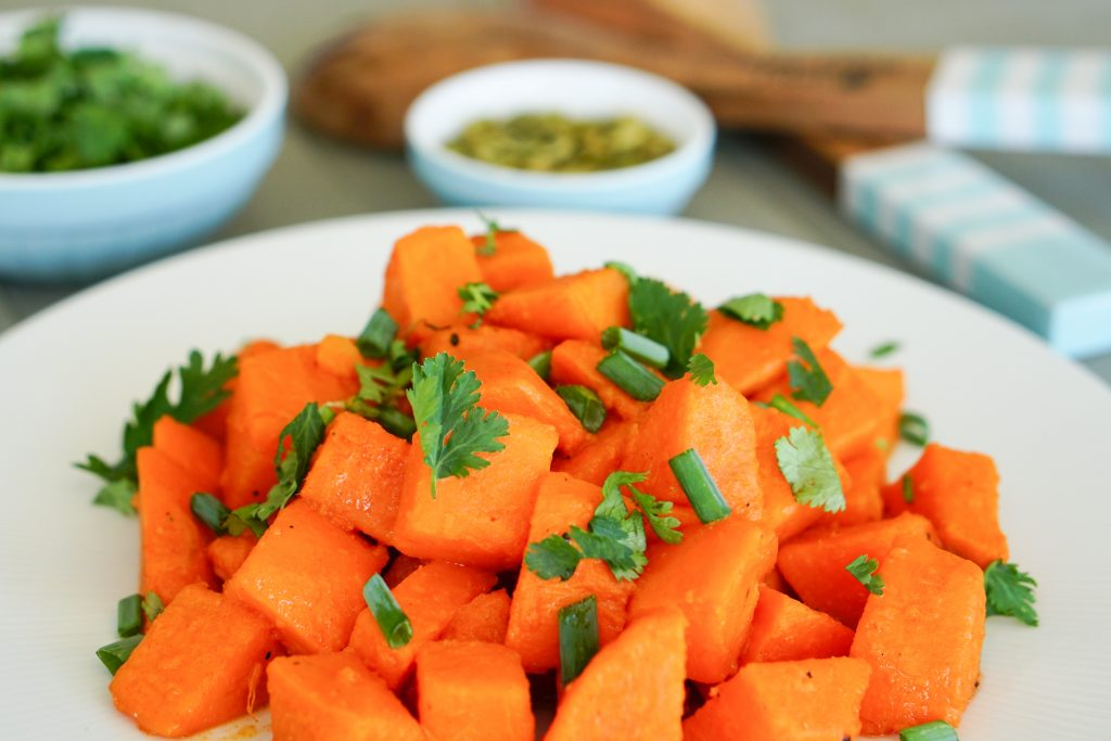 Sweet Potato salad with key lime lexi pinch bowls and salad tongs in background