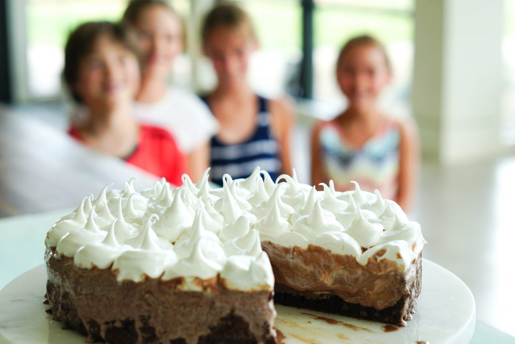 Kids in the background with Chocolate Ice Cream Cake with Cinnamon Brownie