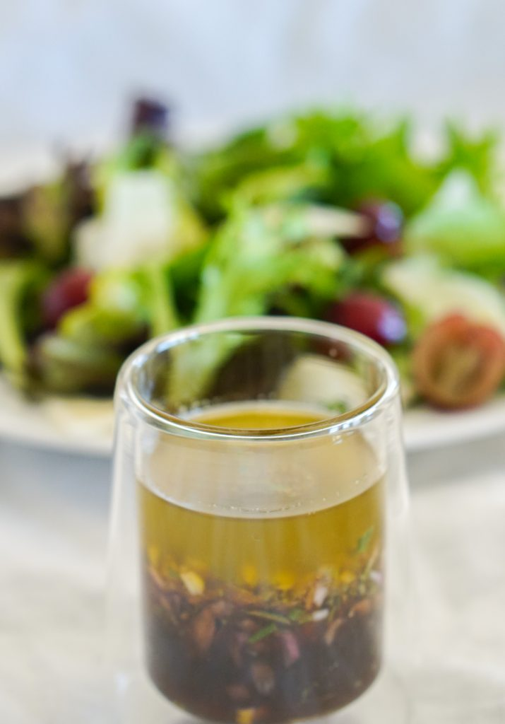 Lemon Shallot Vinaigrette with salad in background