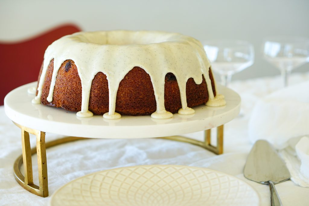 Cranberry Bundt Cake on white and gold cake stand
